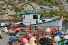 Colored ropes next to fishing vessel at Peggy's Cove