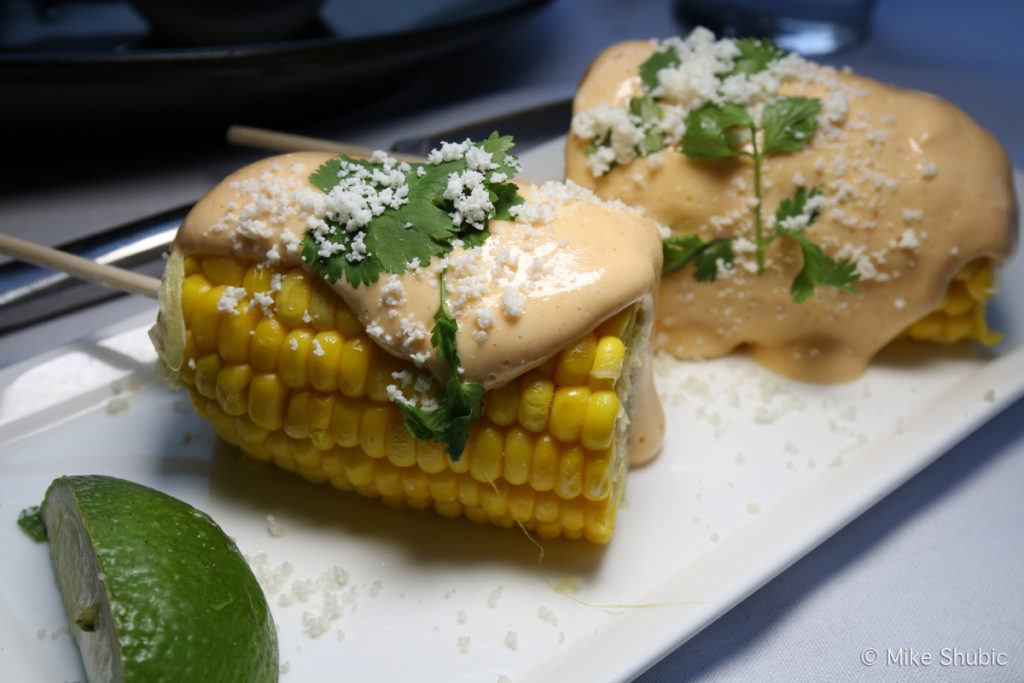Grilled Street Corn - Skewered corn, butter, chila paprika, aji rocoto, cilantro & cotija.