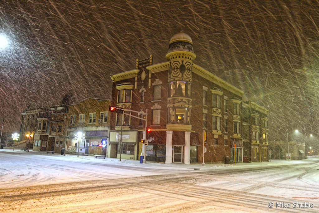 Downtown Janesville during snow storm by MikesRoadTrip.com