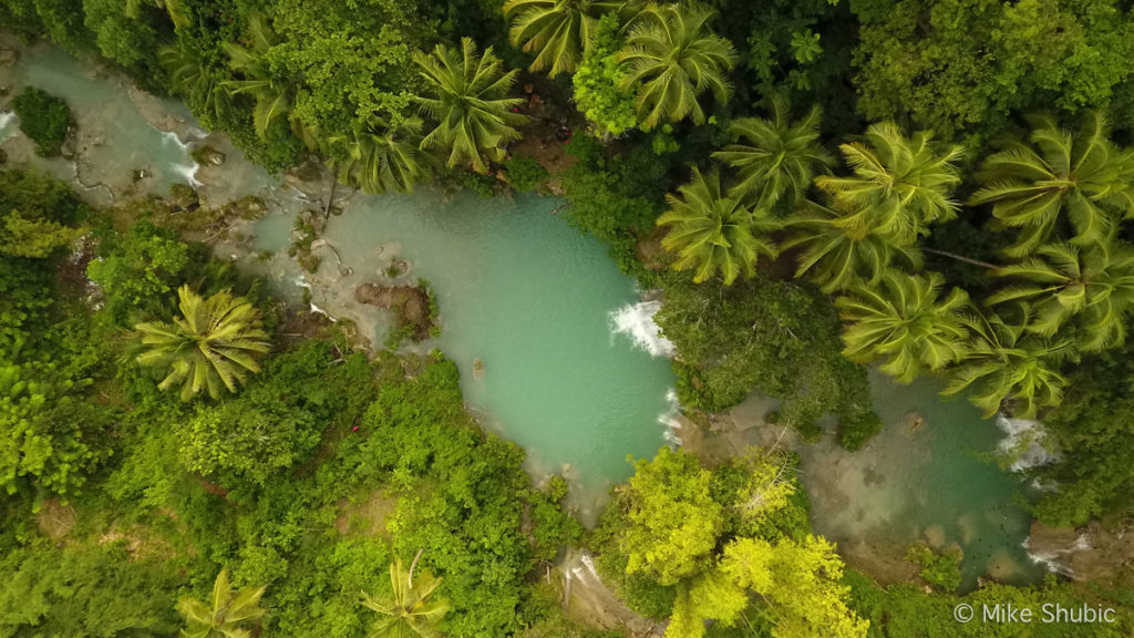 Aerial of Cambugahay Falls on Siquijor island in the Philippines by MikesRoadTrip.com