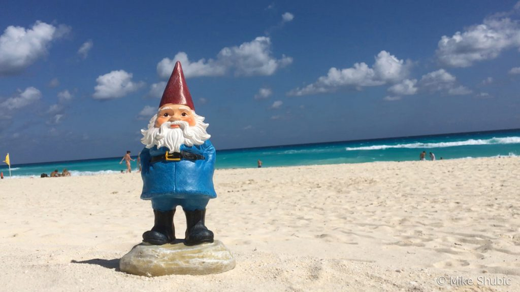 Travelocity Gnome on the beach in Mexico by MikesRoadTrip.com