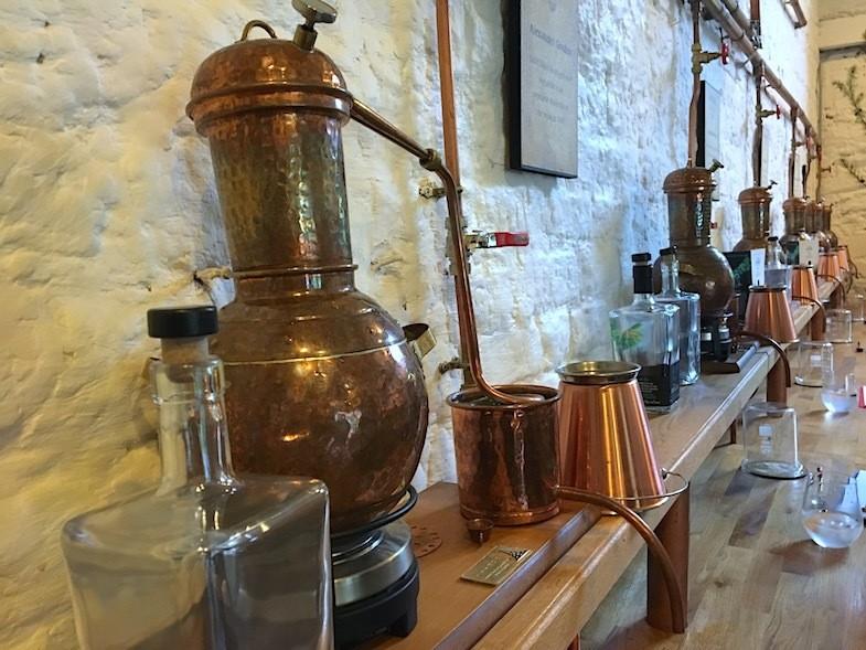 Miniture copper gin stills at Listoke Gin School by MikesRoadTrip.com