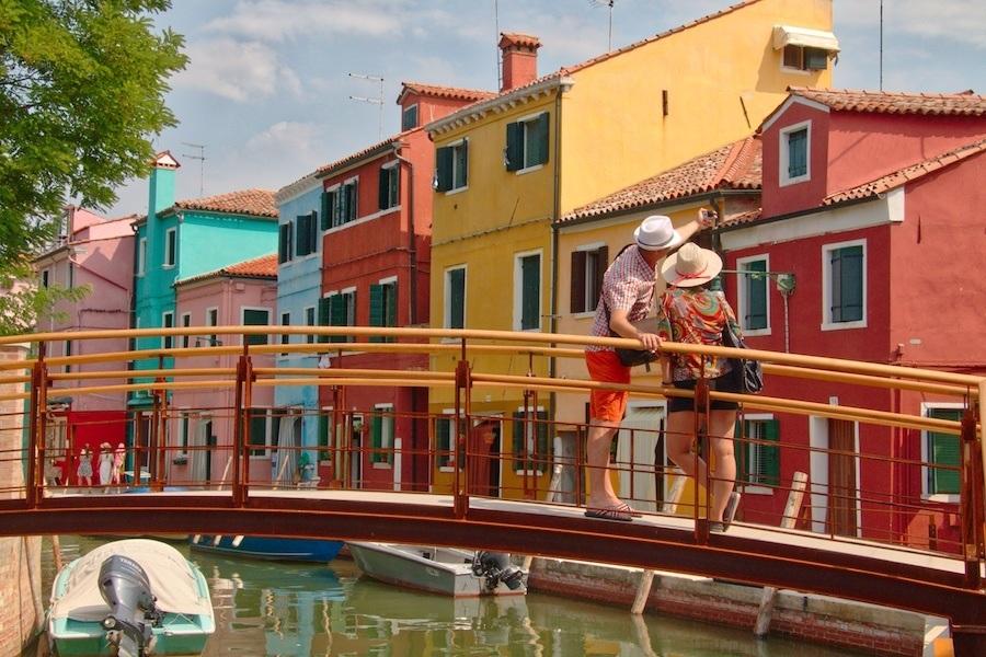 Burano Italy bridge with couple by MikesRoadTrip.com