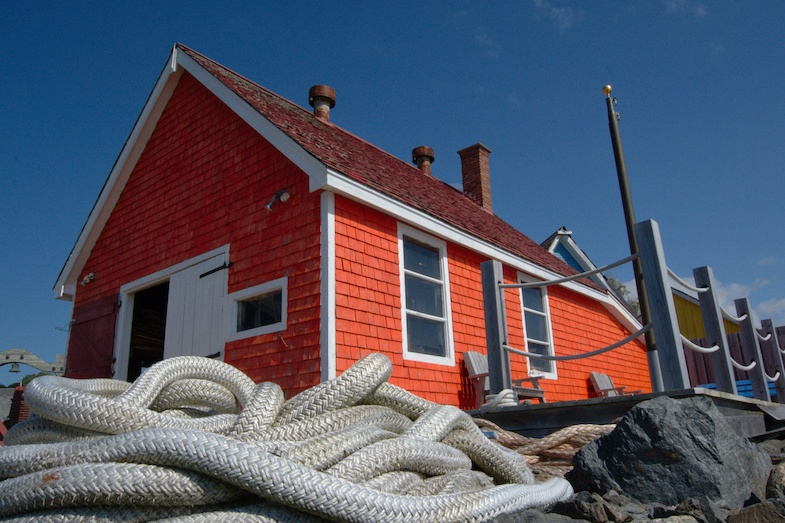 Red boat house in Pictou Nova Scotia by MikesRoadTrip.com